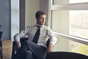 man-wearing-white-dress-shirt-and-black-necktie-716411