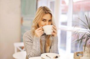woman-in-gray-sweater-holding-white-ceramic-mug-3767355